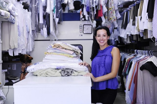 bigstock-happy-owner-of-a-dry-cleaning-6901412-2987701